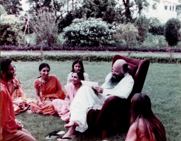 With Osho in Lao Tzu garden, with daughter Videh while Kul is receiving sannyas